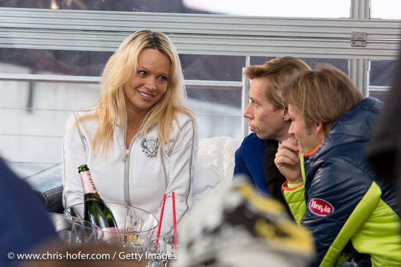 SAALBACH-HINTERGLEMM, AUSTRIA - DECEMBER 05:   Pamela Anderson with manager and event promoter during the third and final day of the Formula Snow 2015 ski opening on December 5, 2015 in Saalbach-Hinterglemm, Austria.  (Photo by Chris Hofer/Getty Images)