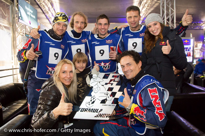 SAALBACH-HINTERGLEMM, AUSTRIA - DECEMBER 05:   KINI Red Bull team members (standing) Timo Scheider, Simo Kirssi, Ben Hemingway, Andi Meklau and Kris Rosenberger with wife Ursula and Son Ben during the third and final day of the Formula Snow 2015 ski opening on December 5, 2015 in Saalbach-Hinterglemm, Austria.  (Photo by Chris Hofer/Getty Images)